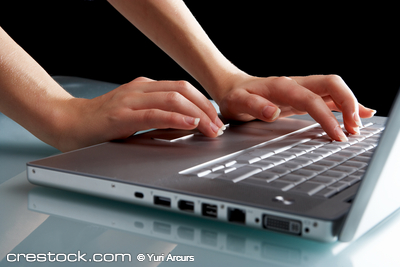 One press of a finger...Modern laptop isolated...